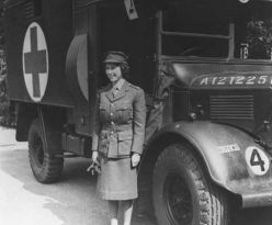 Princess Elizabeth of Windsor in front of her ambulance